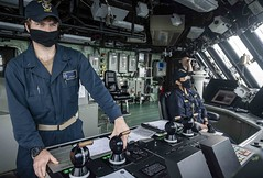 Lt. j.g. Philip McGee helms the Freedom-variant littoral combat ship USS Detroit (LCS 7).