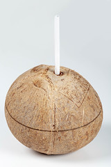 Fresh coconut with drinking straw