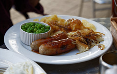 A plate of sausage mash onions and peas Epping Essex, England
