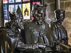 Closeup of Sculpture of King John signing the Magna Carta at Runnymede in the Chapter House of Salisbury Cathedral