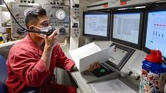 Damage Controlman 2nd Class David Ortiz stands watch aboard USS Russell (DDG 59).
