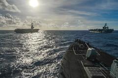 USS Russell (DDG 59) follows USS Theodore Roosevelt (CVN 71), right, and USS Nimitz (CVN 68) in the Philippine Sea.