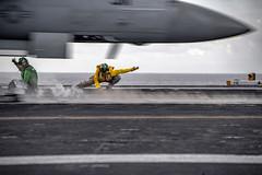 Sailors launch aircraft aboard USS Nimitz (CVN 68).