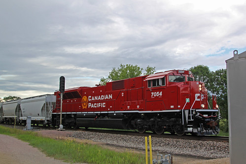 CP 7054 leads 288 through Portage East, entering single track