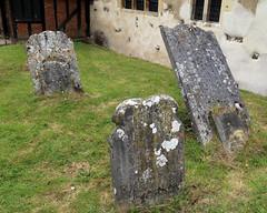 All Saints Church, Nazeing, Essex, England ~ churchyard stones with lichen