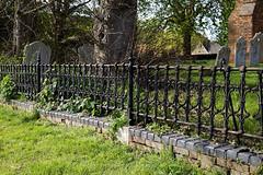 All Saints Church churchyard fence at High Laver Essex England