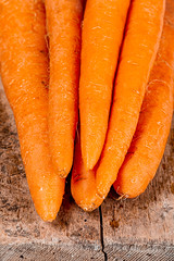 Close-up, carrots on an old wooden background
