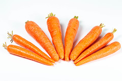 Orange young carrots on white