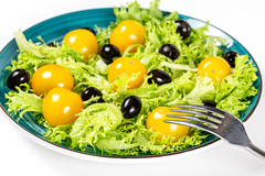 Vegetarian fresh salad with lettuce, cherry tomatoes and green olives
