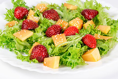 Salad with lettuce leaves and fruit slices