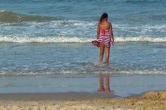Woman standing in the surf