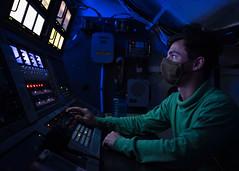 A Sailor stands watch aboard USS Nimitz (CVN 68).