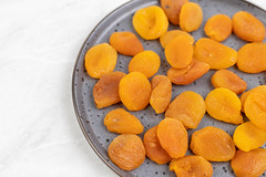 Dried Peaches on the plate with copy space
