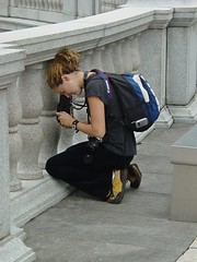 Woman photographing protest