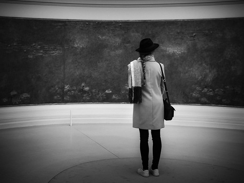 """Woman in Black & White Admires Monet's """"Water Lillies"""""""