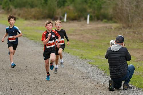Photographer and kids 2km race finish