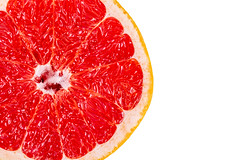 Top view, half of a red grapefruit on a white background