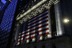 NYSE with American Flag at Night