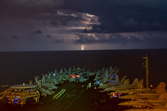 Lightning flashes over the South China Sea in front of USS Nimitz (CVN 68).