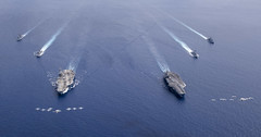 Aircraft fly over the Nimitz Carrier Strike Force.