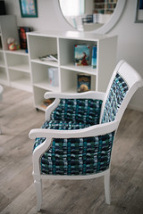 White vintage-looking chair with turquoise and blue seat, interior design