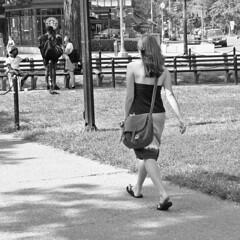 Woman walking through Dupont Circle
