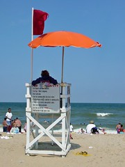 Lifeguard stand with surf warning flag out