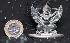 Macro of Thai place card holder to show size against a pound coin