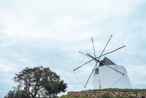 A traditional Portuguese windmill near the Algarve town of Odeceixe, Portugal - negative space composition