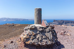The stone marking the summit of the hill on the volcano hike to the crater in Santorini
