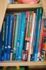 English book collection at home closeup.