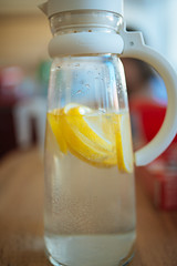 Pieces of lemon resting in hot water for a cake