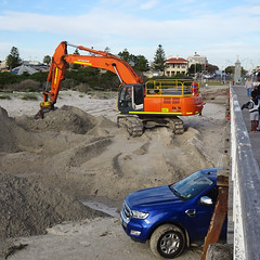 Excavator and Car on Beach