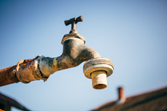 Old, rusty and dry outdoor faucet. Drought