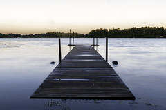 High water surrounding a dock at sunrise on Lingroth Lake in Aitkin, Minnesota