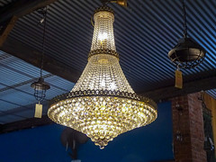 Chandelier Hanging from Corrugated Iron