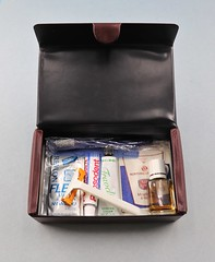 202028001 Amenities Kit Northwest Orient Airlines Gentlemans amenities maroon box includes comb toothbrush toothpaste razor shaving cream cologne mouth wash shampoo travel sizes Date circa mid 1980s