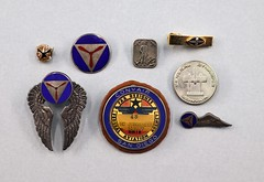041515.JOR.007 Collection of pins buttons Convair General Dynamics and Convair memorabilia tie clasps lapel pins from various years