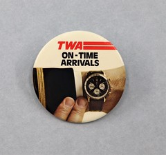 012208.BAR.010 Button TWA On-Time Arrivals Image of a pilots wrist looking at the time on a watch