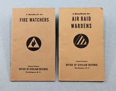 86.60.F Booklets 2 A Handbook for Air Raid Wardens and A Handbook for Fire Watchers Both by the Office of Civilian Defense Date 1941 1942 Tan booklet with black print