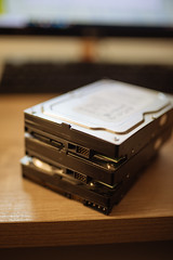 Focused picture of three old hard drives standing on top of each other