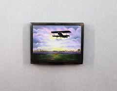 062007.UNK.002 Small metal box Color print aircraft on hinged top Silver metal box gold interior
