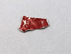 59.65.A1 Aircraft remnant Piece of aluminum cut from a Japanese Betty bomber Mitsubishi G4M Okinanwa 1945 Red aluminum