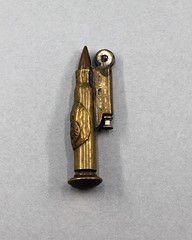 56.179.F Lighter Home-made from rifle caliber cartridge Royal Canadian crown embossed Flint wheel stamped with H&W London Made World War I Brass
