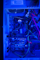 Inside of the old pc case with messy cables