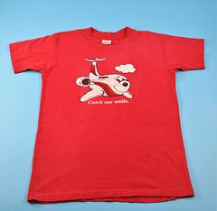 092403 BUT 003 Shirt PSA Childrens t-shirt Catch our smile with smiling PSA plane on front and back Red cotton shirt with white print