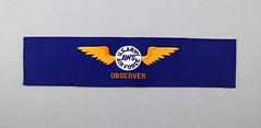 21.4.E Armband US Army Air Force Observer AWS Blue felt with gold embroidered wings white center circle with logo Date circa 1941