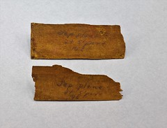 39.76.C Two pieces of plywood veneer recovered from the wreckage of a Japanese aircraft at Singapore Airport Writing on pieces Jap plane at Spore 46 1946