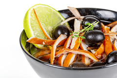Chinese soup with smoked chicken fillet, vegetables and black olives