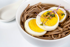 Close up, Chinese soup with brown noodles and chicken egg